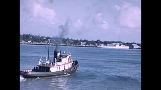 leaving honolulu harbour prior to development / tug boat in foreground - tug boat stock videos & royalty-free footage