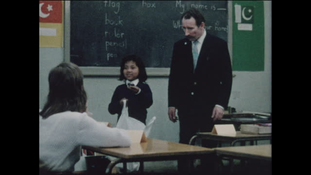 vintage footage of multicultural children being taught in a school in the united kingdom circa 1968. no sound. - multiracial group stock videos & royalty-free footage