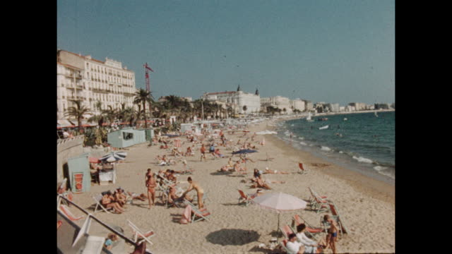 vintage home movie footage from cannes in the south of france circa august 1960 a view of the beach and the mediterranean sea - region provence alpes côte d'azur stock-videos und b-roll-filmmaterial