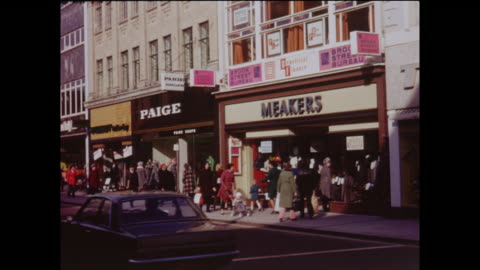 stockvideo's en b-roll-footage met vintage home movie showing the busy high street in the centre of luton, circa 1970 - shopping centre