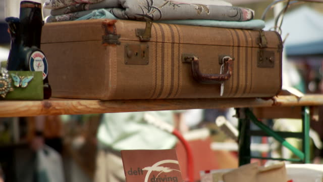 cu td tu selective focus vintage items for sale at flea market stall, new york city, new york, usa - suitcase stock videos & royalty-free footage
