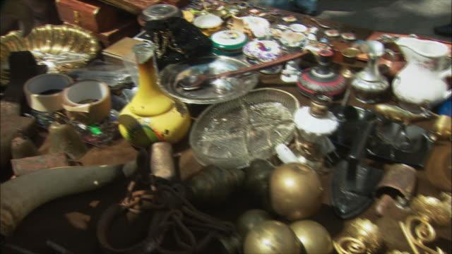 ms vintage items for sale in flea market, el rastro, madrid, spain - flea market stock videos and b-roll footage