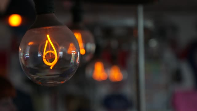 vintage light bulb in cafe - incandescent bulb stock videos and b-roll footage