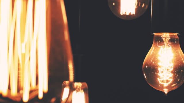 vintage lightbulbs on black - old lightbulb stock videos and b-roll footage