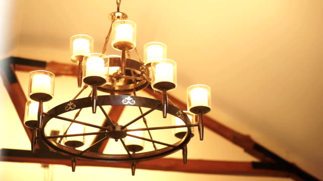 vintage lighting hanging from the ceiling, lighting decoration. - lampada elettrica video stock e b–roll