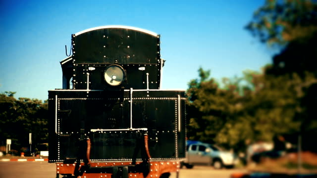 Vintage locomotive stands in the exhibition in the rail yard.