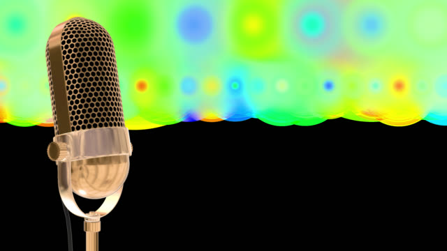 Vintage microphone on microphone stand with cascading stars and glowing circles saved with alpha channel