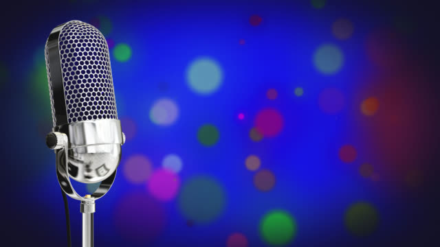 Vintage microphone on microphone stand with glowing circles on a blue background