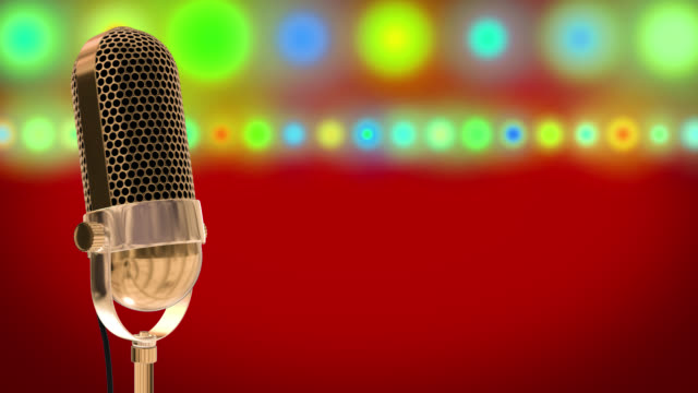 Vintage microphone on microphone stand with glowing circles on a red background