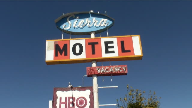 ms, la, vintage motel sign against clear sky, california, usa - motel stock videos and b-roll footage