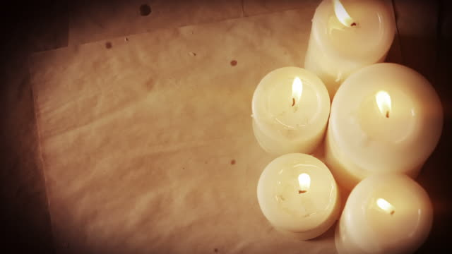 stockvideo's en b-roll-footage met vintage paper and candles - candlelight