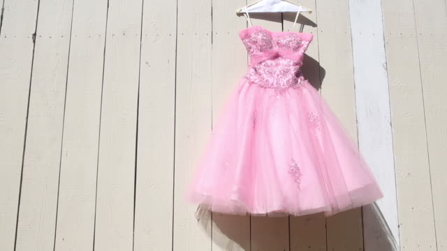 vintage pink cocktail dress hanging on fence - second hand stock videos & royalty-free footage