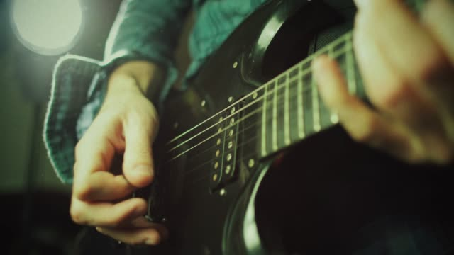 vintage rock guitarist playing guitar - guitar stock videos & royalty-free footage