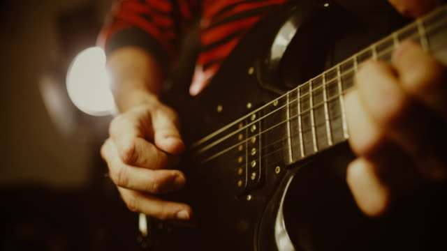 vintage rock guitarist playing guitar - rock group stock videos & royalty-free footage