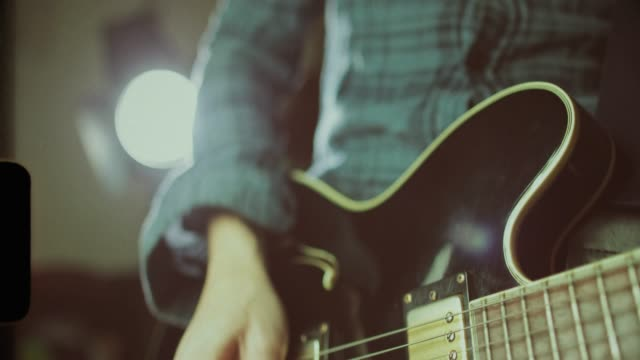 vintage rock series: guitar player - rocking stock videos & royalty-free footage
