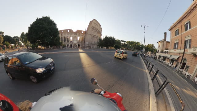 pov 360 vintage scooter riding: friends on the motorbikes under the coliseum of rome - scooter stock videos & royalty-free footage