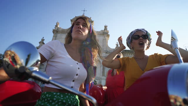 vintage scooter riding: girl friends with motorbikes in the center of rome - female friendship stock videos & royalty-free footage