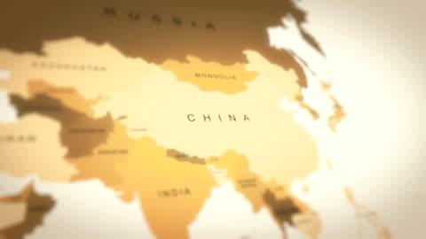 4k vintage sepia färgad världskarta, zooma in till asien (kina) animation - kartografi bildbanksvideor och videomaterial från bakom kulisserna