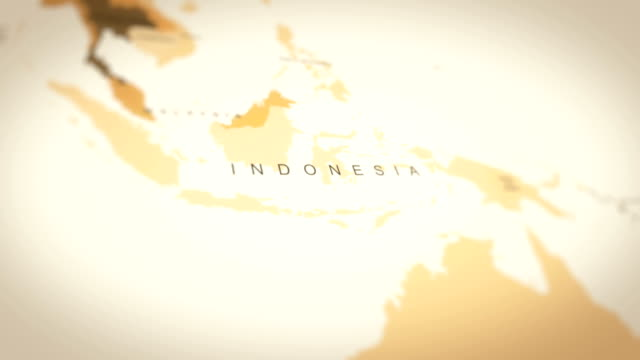 4k vintage sepia colored world map, zoom in to asia animation (indonesia) - indonesia map stock videos & royalty-free footage