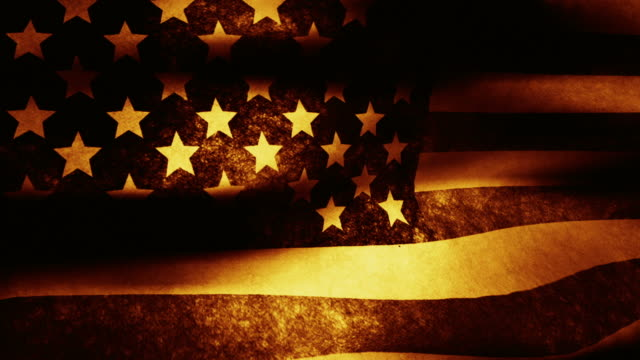 stockvideo's en b-roll-footage met a vintage, sepia toned american flag waves in the breeze. - monochroom