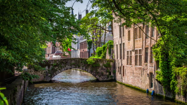 vintage stone bridge over a canal in bruges, belgium - belgium stock videos & royalty-free footage
