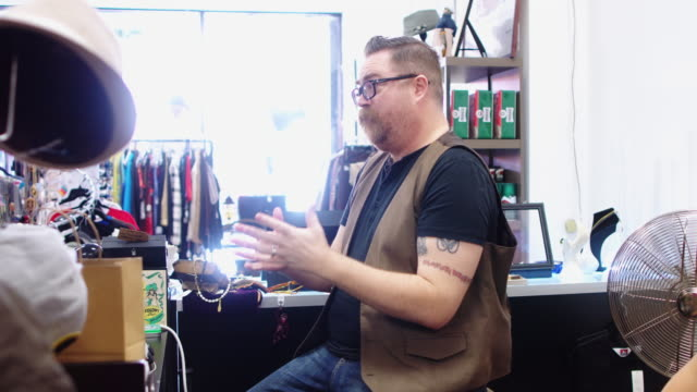 vintage store owners chatting with customers - second hand stock videos and b-roll footage