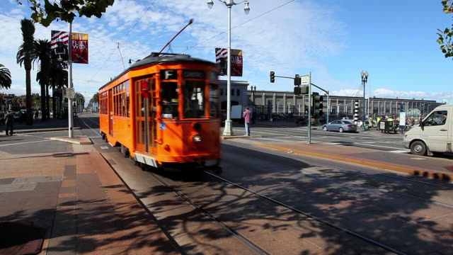 WS Vintage street car moving on road in city  / San Francisco, California, United States