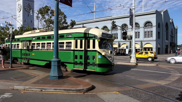 vidéos et rushes de ws vintage street car moving on road in city  / san francisco, california, united states - ligne de tramway