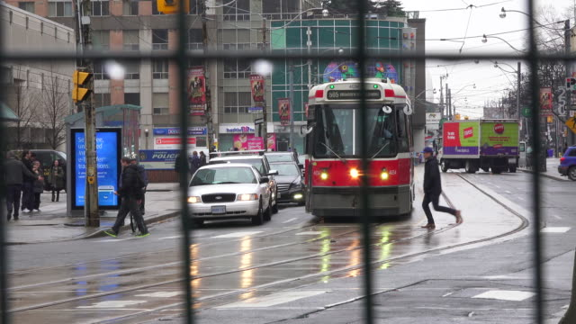 Vintage streetcar and traffic in downtown Toronto