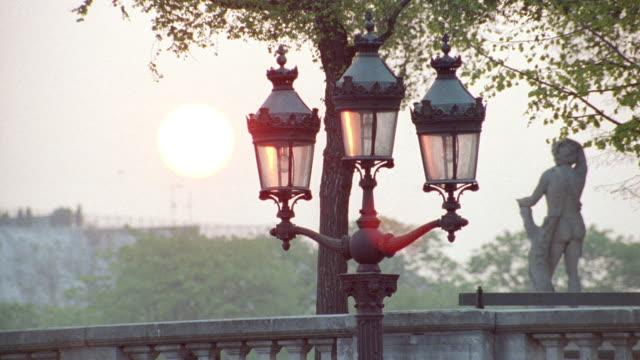 vintage streetlamps adorn a quaint city street in paris. - 1995 stock videos & royalty-free footage