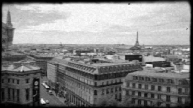 vintage style black and white film footage looks over the palais garnier and parisian rooftops towards the eiffel tower. - newsreel stock videos & royalty-free footage