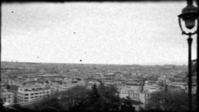 vintage style handheld film footage overlooks the paris skyline from sacre coeur in montmartre. - basilique du sacre coeur montmartre stock videos & royalty-free footage