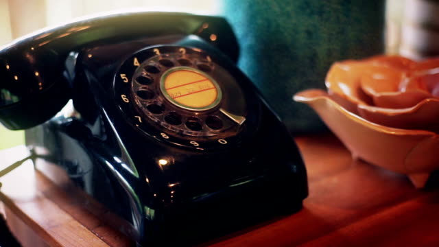 vintage telephone on a wooden table near the window. - the past stock videos & royalty-free footage