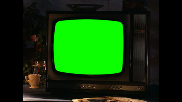cu of vintage television set with green screen - device screen stock videos & royalty-free footage