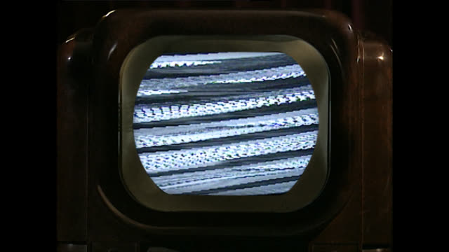 cu of vintage television set with static noise on screen - television static stock videos & royalty-free footage