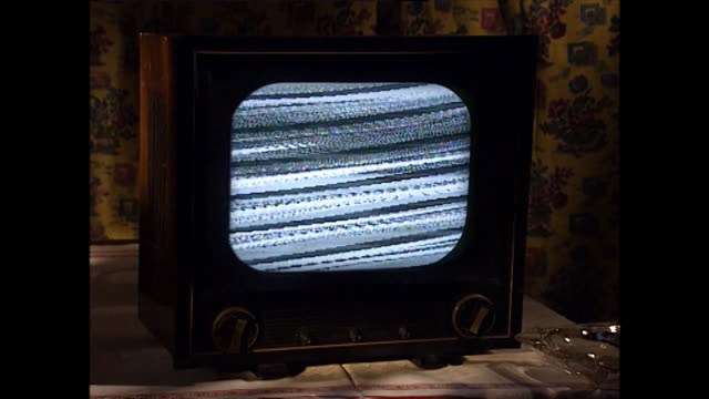 vintage television set with static noise on screen - television static stock videos & royalty-free footage