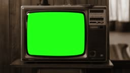 Vintage Television With Green Screen. Sepia Tone. Zoom Shot.