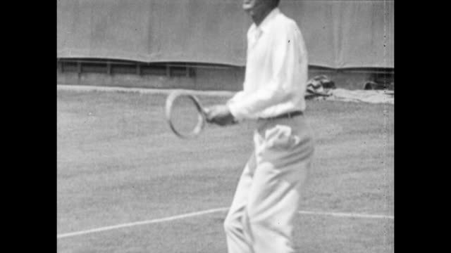 Vintage tennis action featuring a mens singles match at the Westside Tennis Club in Forest Hills between Bill Tilden and Vincent Richards in the US...