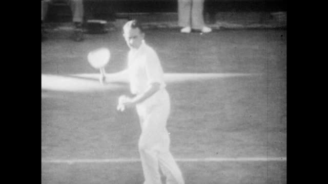 Vintage tennis action featuring Jack Crawford of Australia in action against Fred Perry of Great Britain in the Final of the US Tennis Championships...