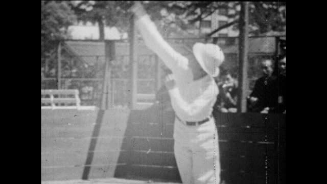 Vintage tennis action featuring the Crown Prince Akihito of Japan circa 1953