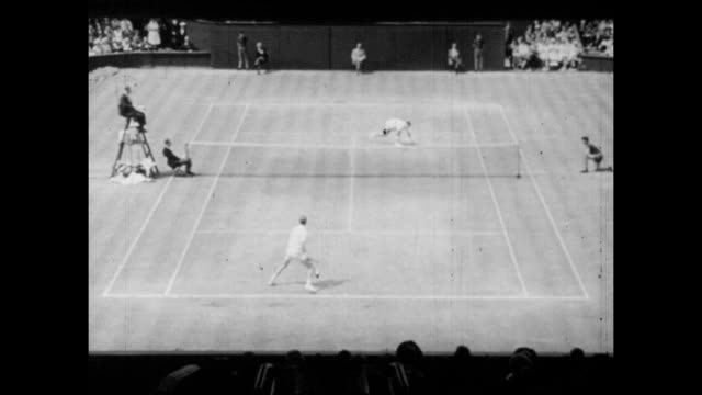 Vintage tennis action featuring the Wimbledon mens singles final between Fred Stolle and Roy Emerson on Centre Court at the All England Lawn Tennis...