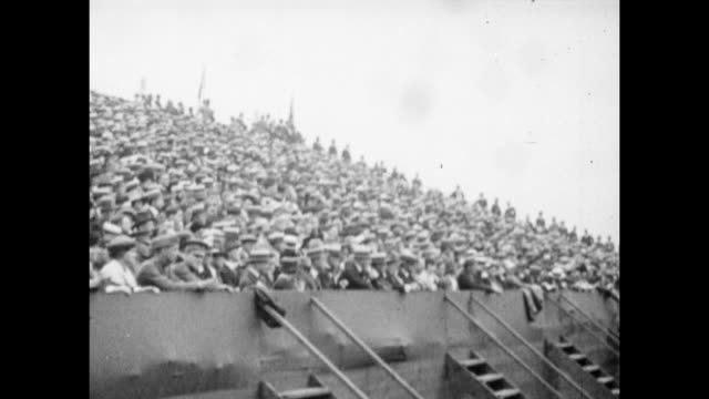 Vintage tennis featuring a large crowd at the Westside Tennis Club in Forest Hills watching 'Big' Bill Tilden and 'Little' Bill Johnston in the Final...