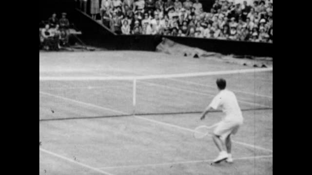 Vintage tennis featuring Bunny Austin of Great Britain against Don Budge of the United States in their men's singles quarter final match on Centre...
