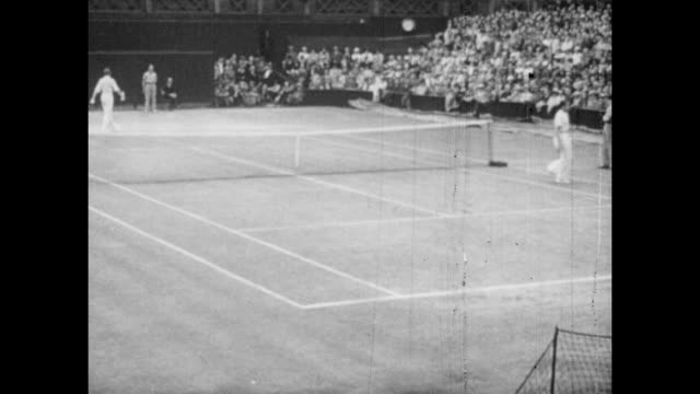 Vintage tennis featuring Don Budge of the USA and Baron Gottfried Von Cramm playing their 1937 Davis Cup match at Wimbledon in London 20th July 1937...