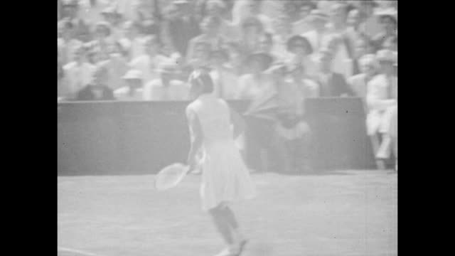 Vintage tennis featuring Jadwiga Jędrzejowska of Poland playing against Alice Marble of the United States in the Final of the Eastern Grass Court...