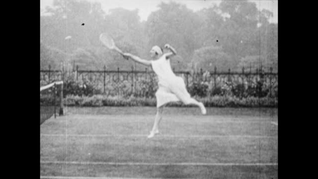 vintage tennis slow motion action featuring suzanne lenglen of france, circa 1920 - match sport stock-videos und b-roll-filmmaterial