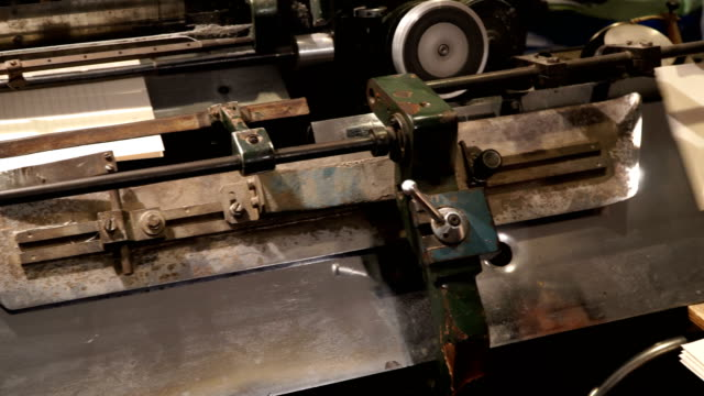 vintage thread book sewing machine work – how to print book in old style technology - druckmaschine stock-videos und b-roll-filmmaterial