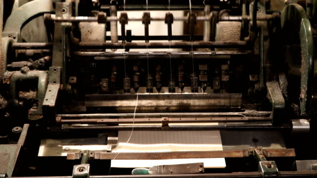 vintage thread book sewing machine work – how to print book in old style technology - old book stock videos and b-roll footage
