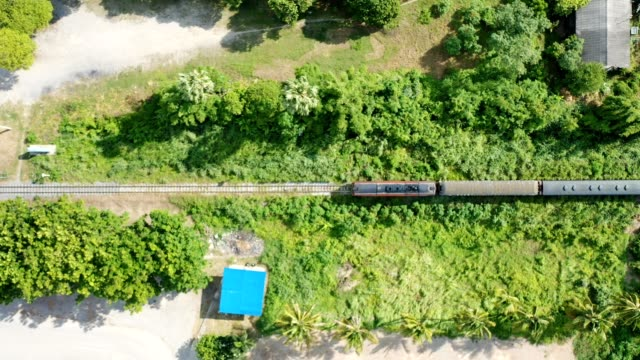 stockvideo's en b-roll-footage met vintage trein met passagier draaistel draait op de spoorwegen op het platteland - passenger train
