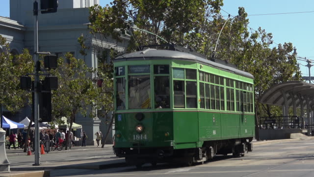 vintage trolley car leaving the station - san francisco ferry building stock videos & royalty-free footage